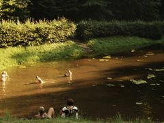 People swimming in dirty water by <b>Guido Musch</b> ( a Panoramio image )
