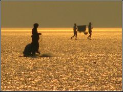 The Golden beach--The beach with local fishermen at sunset. by <b>Rhitamvar Ray</b> ( a Panoramio image )