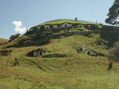 Hobbiton movie set near Matamata from Lord of the Rings trilogy. by <b>Vilmis</b> ( a Panoramio image )