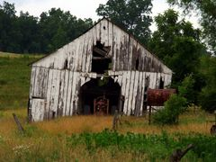 Old tractor, old shed by <b>Ryan Calhoun</b> ( a Panoramio image )
