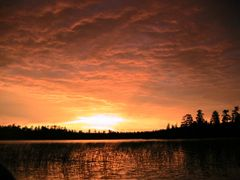 sunset over Susan Bay, Pelican Lake, Orr, Minnesota by <b>Brad Bergstrom</b> ( a Panoramio image )