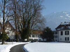 """Interlaken, church and castle. Mountain in the background = """"Sch by <b>kurt.fotosuisse</b> ( a Panoramio image )"""