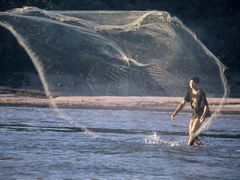 Fisherman on Mekong of Luang Prabang by <b>JohnMacdonald</b> ( a Panoramio image )