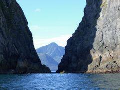 Russia, Kamchatka. My son is passing in his kayak between the ro by <b>Olga Yakovenko</b> ( a Panoramio image )