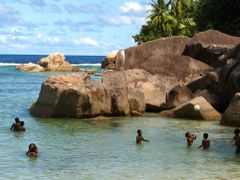 Creole children playing by the granite rocks at the seaside by <b>Daniel Balazs Harcz</b> ( a Panoramio image )