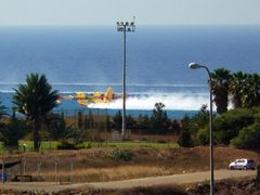 Fire-fighting aircraft  takes water from the sea..... (Photo fro by <b>nadiakushnir</b> ( a Panoramio image )