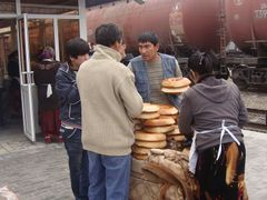 Uzbek Origin Bread vendors at Samarkand Train Station by <b>shumali</b> ( a Panoramio image )