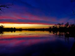 Blue Red Purple Golden Sunset with Water Reflection and Silhouet by <b>Kalin Ranchev</b> ( a Panoramio image )