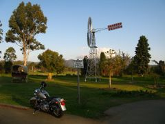 The wind wheel and a Harley at Bearded Dragon Restaurant by <b>fotokonig</b> ( a Panoramio image )