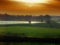 Sunset over a farm dam by <b>j. adamson</b> ( a Panoramio image )