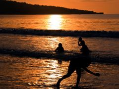 Water games at sunset of the beach Jimbaran, Bali by <b>pilago</b> ( a Panoramio image )