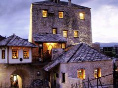 Mostar and an evening image from the old stone bridge by <b>Ahmet Bekir</b> ( a Panoramio image )