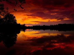 Red Orange Golden Sunset with Lake Reflections - Jacobson Park ( by <b>Kalin Ranchev</b> ( a Panoramio image )