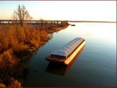 River Barge from the Mississippi Bridge (Rte 62)  by <b>Tomros</b> ( a Panoramio image )
