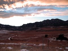 Sun setting behind the Rockies (Rocky Mountains), Boulder CO by <b>BobbyV</b> ( a Panoramio image )