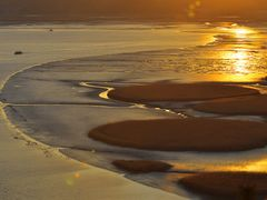 Sunset reflected in the mud by <b>ssSUH</b> ( a Panoramio image )