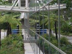 Reflective entry to the Arrivals Hall at Brisbane International  by <b>Ian Stehbens</b> ( a Panoramio image )