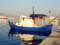 The blue boat in the port of Volos (NIKON EM) by <b>Thanasis Germanos</b> ( a Panoramio image )