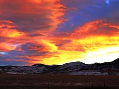 Sunset on route to Boulder, CO from Denver CO by <b>BobbyV</b> ( a Panoramio image )