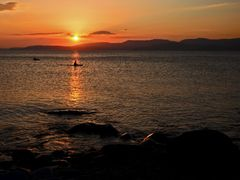 Kayak Sunset by <b>Dean Matthews</b> ( a Panoramio image )