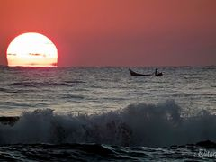 Waves at sunrise by <b>Eliton Sloma</b> ( a Panoramio image )