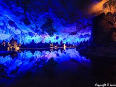 Stalactite Reflection inside Reed Flute Cave -- ??? by <b>AmJB</b> ( a Panoramio image )