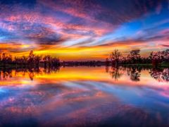 Colorful Sunset Panorama with Symmetrical Reflections - Jacobson by <b>Kalin Ranchev</b> ( a Panoramio image )