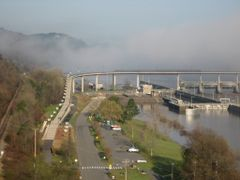 Big Dam Bridge partially obscured by fog by <b>frankcanfly</b> ( a Panoramio image )