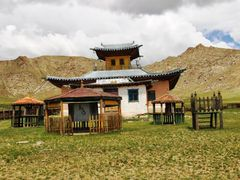Cycle in Mongolia: temple yard and the back mountain by <b>jlguo</b> ( a Panoramio image )