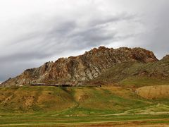Cycle in Mongolia: a strange hill by <b>jlguo</b> ( a Panoramio image )