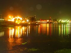 Lago Peten at night, Flores/Santa Elena, Guatemala by <b>NellvdBoschLevendig</b> ( a Panoramio image )