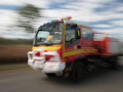 Fire Truck racing to a fire by <b>Aaron Kelly</b> ( a Panoramio image )
